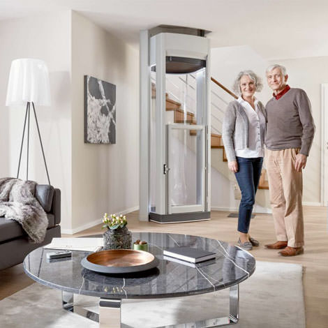 couple infront of an installed home lift