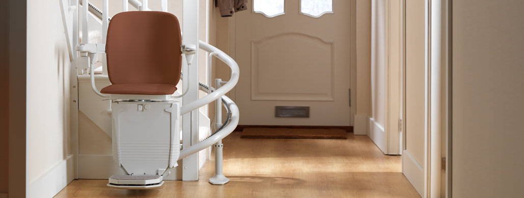 The basic stairlift model at the bottom of stairs