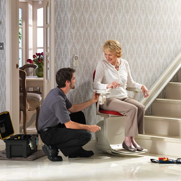 Lifta technician with women on Stairlift